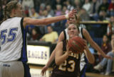 (from right) Windsor's Alex Neely attempts to shoot past Broomfield's Anna Prins in a game...