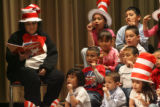 JM1029 -  Ann Franco (cq) (at left) participates in a reading of Dr Seuss's birthday at Del Pueblo...