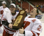 VTTT106 - Wisconsin players Bobbi-Jo Slusar, left, and Phoebe Monteleone celebrate their victory...