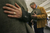Gary McMahan (cq), from Pueblo, CO, bows his head as he joins in prayer before dinner at the Event...