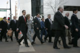 BG0369 Former Qwest CEO Joe Nacchio and his entourage arrive for jury selection at the Federal...