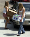 (BOULDER, CO. - AUGUST 17, 2004)  Alassa Smith, right, helps freshman Chelsey Arnold move into her...