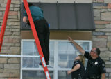 Broomfield police look at a first floor awning that might have softened the fall of a two-year-old...