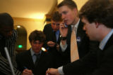 August Ritter III, cq, (center) son of the Governor Bill Ritter, lobbies on his cell phone, Monday...