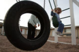 DLM1936  Andrea Thurber pushes her two-year-old daughter, Brianna, on a swing at The Crossing, a...