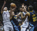 ERA102 - Denver Nuggets' Linas Kleiza (4) battles for a rebound with New Jersey Nets' Josh Boone...