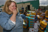 DLM1315  Shelter director Mary Warren, right, is overcome by the generosity of the people donating...