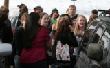 Students stand outside of Evergreen high School Tuesday morning March 6, 2007 after a fire was...