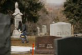 (DLM4465) -  A groundskeeper rakes leaves at the Green Mountain Cemetery in Boulder, Colo. Tuesday...