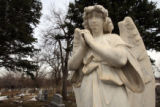 (DLM4465) -  A statue stands at the Green Mountain Cemetery in Boulder, Colo.  where teens Bryan...