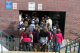 Students return to class at  Evergreen High School Tuesday morning March 6, 2007 after a fire was...