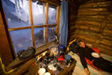 Diane Van Deren in a cabin at the Puntilla Lake Road house, Iditarod Trail Ultra race, Alaska