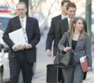 JOE525 Federal prosecutor Leo Wise, far left, walks with Justice Department paralegal Jessica...