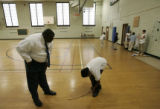 Smiley Middle School Principal Nate Howard asks sixth-grader Erin Urasery, 12,  to tie his shoe...