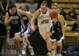 Jenessa Burke of Highlands Ranch (l) chases down #25 Hannah Tuomi (r) down the court in the 4th...