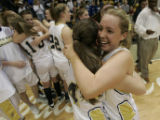 After winning the game in overtime Legacy players Cassie Long hugs Mara Cosgrove (l-r)  in the ...