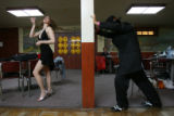 DLM2084   Catherine Bull, left, puts on make-up as Carlos Arenas stretches his legs as they and...