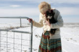 Yolanda Welch (cq) closes a gate to property at  her farmhouse, February 15, 2007 in Wellington,...