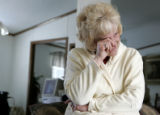 Yolanda Welch (cq) wipes tears from her eyes in her home, February 15, 2007, as she remembers the...