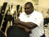 (CENTENNIAL Colo., Aug. 31, 2004)   Cedric Smith, Broncos' assistant strength coach, in the weight...