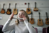 Sarah Hawkey, 10, practices proper lip formation to play the flute during her music class Feb. 14...