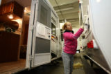 Maria Reyes, cq, of R.V. America wipes down the exterior of a camper trailer Wednesday Feb. 28,...
