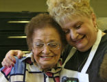 Phyllis Martin, (cq), right, shows her appreciation for the volunteer work by Mary Rotola, (cq),...