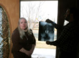 Laura Schultz, (cq), left, with her husband Jeff Schultz (cq) holding one of many X-rays of her,...
