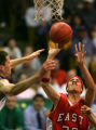 Mookie Gilbert, of East, puts up a shot over Garret Fiddler in the first half of Doherty against...
