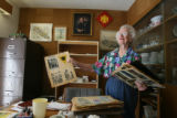 (DLM4465) -  Mary Sparks goes through some of her old scrapbooks filled with photos and newspaper...