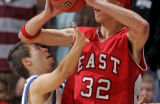 Doherty's Dave Lucero, left, meets East High School's Mookie Gilbert's elbow in the second quarter...
