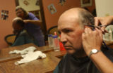 (Eagle, Colo., September 1, 2004) David Barton, of Eagle, gets his hair cut at Kuttin' Korner in...
