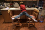 Jack Koskinen, 8, works on his homework at the kitchen counter of his family's home. (ROCKY...