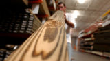 (DENVER, Colo., May 17, 2004) Joel Whitley, owner of JW Home Services, checks to see if the lumber...