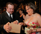 Mike Brown, and his fiance, Kimi Porterfield, look to see what's in their surprize gift box....
