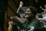 Mildred Palmer applauds and cheers for her daughter Cheri Palmer with Machebeuf as she comes off...