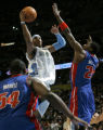 Denver Nuggets Carmelo Anthony score two of his 16 first half points as he splits the Detroit...