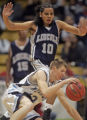 Ralston Valley's Ken Webber, bottom, tries to control his dribble in the second quarter of play...