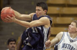 Abraham Lincoln's Sean Murphy, left, grabs a rebound over Ralston Valley's Ken Webber, right, in...