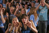 Ralston Valley Mustangs student Kyle Kazemi (CQ) cheers on his school against the Abraham Lincoln...
