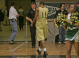 Aurora Central Trojans' star Stephen Franklin walks off the court after losing in the  5A State...