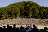 OLYMPIA, GREECE, AUGUST 18, 2004) Crowds gather around the Ancient Stadium in Olympia, Greece, to...