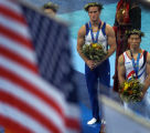 (ATHENS, Greece  on Wednesday, Aug. 18, 2004) - American gymnast Paul Hamm looks at the U.S. flag...