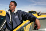 Cab driver, Ahmed Odawaay (cq) waits in the taxi holding lot at DIA for his turn for a fare at the...