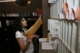 Erlinda Ramirez, (cq) is working sorting mail as part of her receptionist duties within Wells...