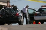 A law enforcement official investigates an officer involved shooting in the 3200 block of South...