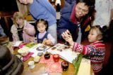 Three and a half year old Kaixin Cui (right) and her father Ming Xue Cui look at a demonstration...
