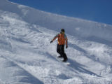 Coming off a cornice, Josh Shramo of the A Basin Snow Sports School keeps his body perpendicular...