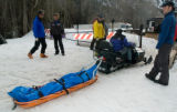Zach Ornitz/Aspen Daily News Rescue workers transport the body of an avalanche victim to the...