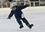 John Ryan-Senderling, 5, of West Palm Beach, Florida, takes a fall while skating at The Rink at...